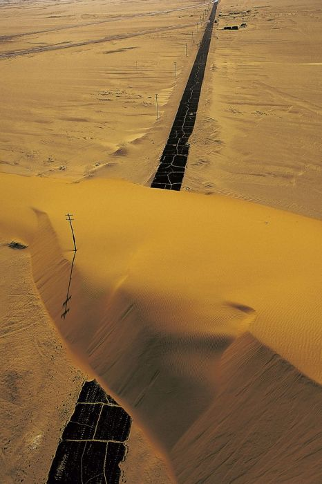 Egypt, Road interrupted by a sand dune